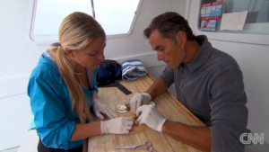Lyon and a scientist cut open a fish stomach to inspect for plastic litter while filming a documentary on ocean pollution.